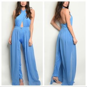 Striking dressy romper with side panel trains
